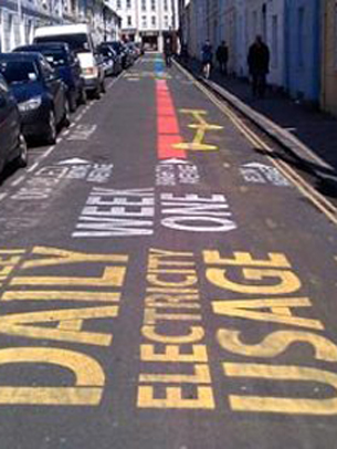 Tidy Street in Brighton is wearing its energy use on its sleeve by recording their daily energy usage and telling the world about it in a giant infographic painted on the street outside